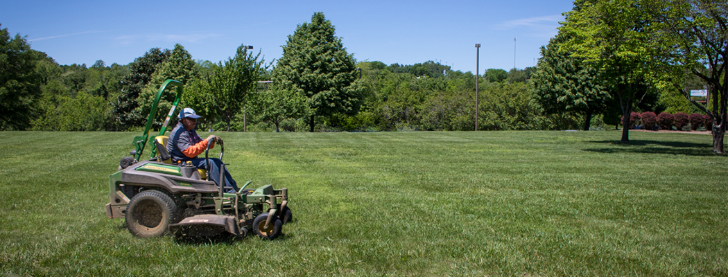Lawn mowing commercial properties with regular grounds maintenance